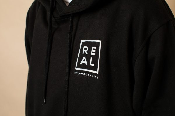 Close up of REAL Snowboarding black hoodie